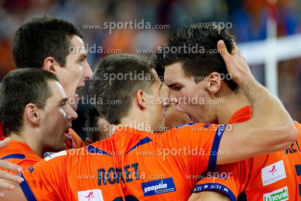 Andrej Flajs of ACH, Gregor Ropret of ACH and Alen Sket of ACH celebrate during volleyball match between ACH Volley LJUBLJANA and Budvanska Rivijera BUDVA.of 2012 CEV Volleyball Champions League, Men, League Round in Pool F, 2nd Leg, on October 26, 2011, in Arena Stozice, Ljubljana, Slovenia.  ACH Volley defeated Budvanska Rivijera 3-2. (Photo by Vid Ponikvar / Sportida)