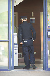©Licensed to London News Pictures 05/07/2020     <br /> Greenwich, UK. A police officer near the main reception arear. Detectives are investigating an incident in which a woman was fatally stabbed at the Holiday Inn Express in Greenwich, London. While police attended the scene a male believed to be known to the woman jumped from height, he is in a life threatening condition in hospital.  Photo credit: Grant Falvey/LNP