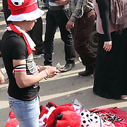 A young entrepreneur seizes an opportunity to sell symbols of national pride in Cairo's Tahrir Square.