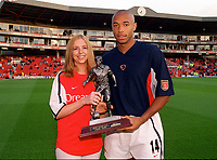 Thierry Henry recievces the Islington Gazette player of the year award. Arsenal 2:0 Liverpool, F.A.Carling Premiership, 21/8/2000. Credit : Colorsport / Andrew Cowie.