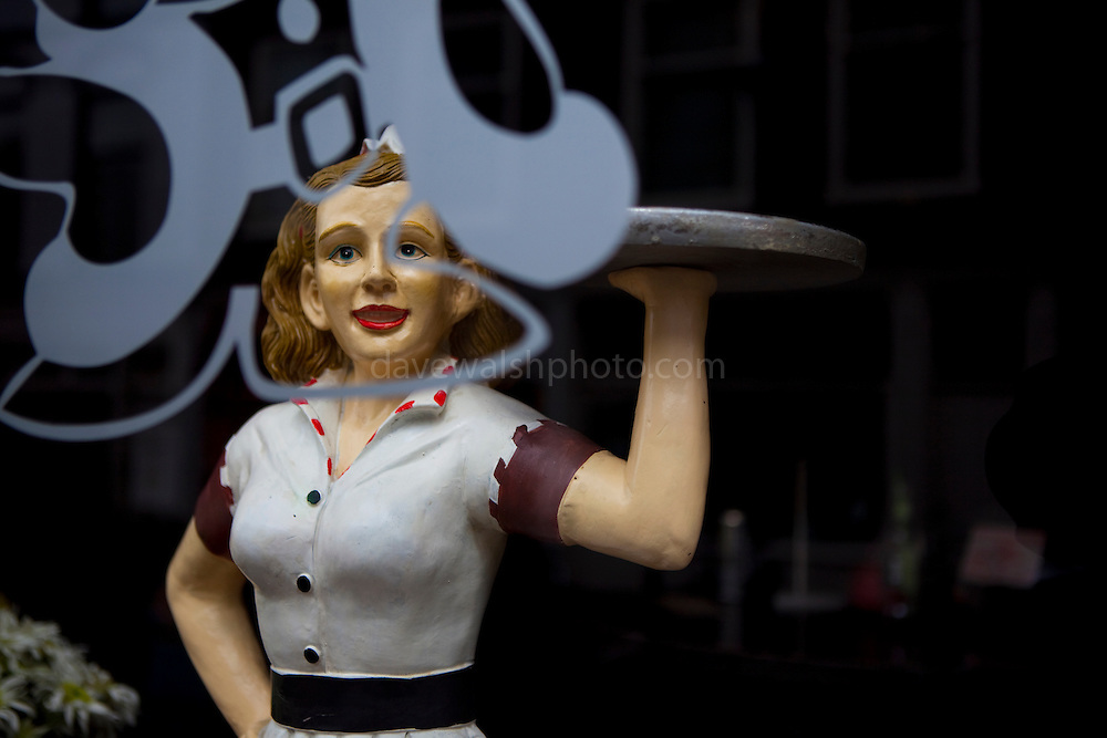 Statue of waitress in cafe window, The Hague