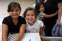 From left, Elvira, 7, Jessica, 6, and Stormy Ferrel, 4, sign in at the El Dorado Park Recreation Center for a four-hour City of Salinas Parks and Community Services program in which they can use the play facilities under gentle supervision. The center has toys, games, art supplies and sports equipment, and offers free lunch and snacks daily through August 8th. Similar comprehensive summer programs are offered by the city at the Breadbox, Central and Firehouse Recreation Centers, as well as the Hebbron Family Center in Salinas.
