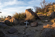 A simple white cross marks the spot where James Boyd was killed by the police in the foothills of the Sandia Mountains in Albuquerque New Mexico.