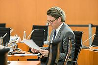 03 JUN 2020, BERLIN/GERMANY:<br /> Andreas Scheuer, CSU, Bundesverkehrsminister, liest in seinen Unterlagen, vor Beginn einer Kabinettsitzung, zu Umsatzung der Abstandsregeln im Internationalen Konferenzsaal, Bundeskanzleramt<br /> IMAGE: 20200603-01-002<br /> KEYWORDS: Corvid-19, Corona, lesen, Kabinett, Sitzung