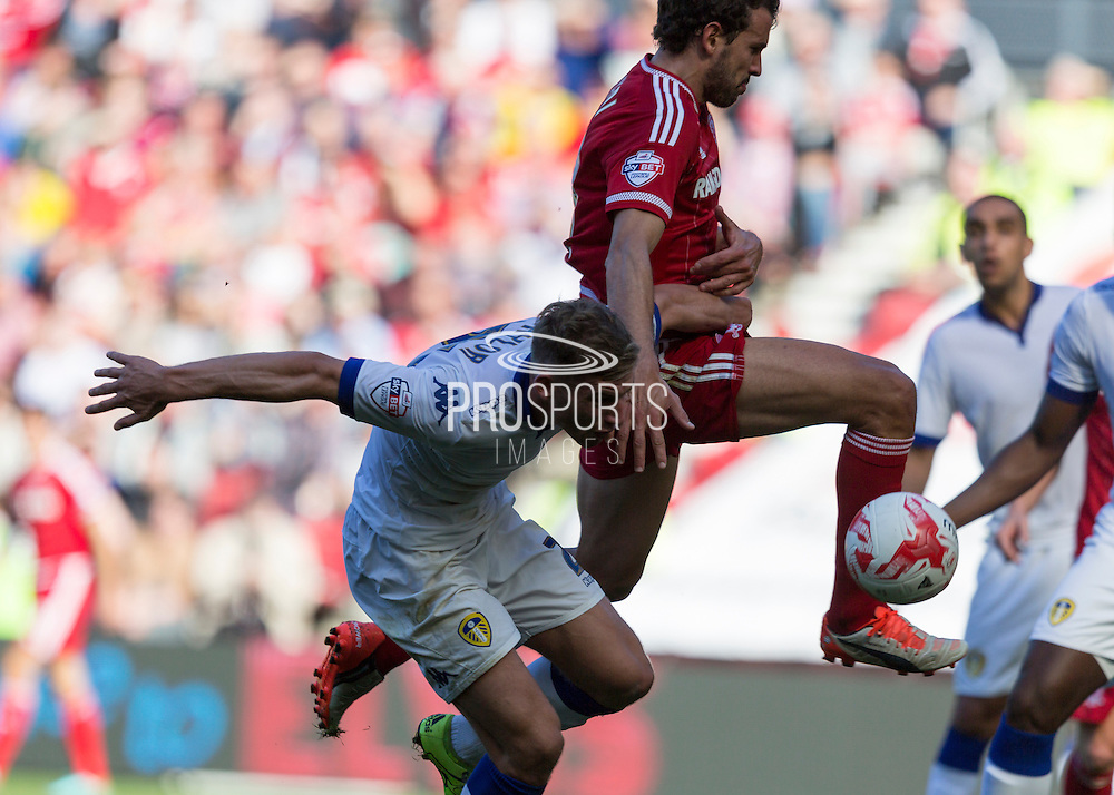 Middlesbrough FC striker Christian Stuani holds the ball under extreme pressure from Leeds United FC defender Charlie Taylor  during the Sky Bet Championship match between Middlesbrough and Leeds United at the Riverside Stadium, Middlesbrough, England on 27 September 2015. Photo by George Ledger.