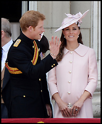 : Prince Harry with the Duchess of Cambridge as they watch the fly past on the Balcony of Buckingham Palace during Trooping The Colour, London, United Kingdom,<br />