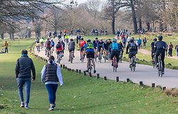 """© Licensed to London News Pictures. 27/02/2021. London, UK. Cyclists enjoy the sunshine in Richmond Park, South West London this afternoon as weather forecasters predict a mild and sunny weekend. This week, Prime Minister Boris Jonson announced his """"Roadmap Map' out of Lockdown with a gradual unlocking of Covid-19 restrictions over the next few months. Photo credit: Alex Lentati/LNP"""