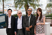 Actors Ryo Kase, Tadashi Okuno, Director and scriptwriter Abbas Kiarostami, Actress, Rin Takanashi, at the Like Someone In Love film photocall at the 65th Cannes Film Festival France. Monday 21st May 2012 in Cannes Film Festival, France.