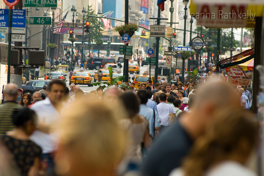 Business people and tourists fill the sidewalks near W 46th at Little Brazil in downtown Manhattan, New York City, USA