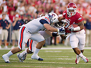 Arkansas running back Dennis Johnson (33) gets past Auburn defenders during an NCAA college football game on Saturday, Oct. 8, 2011, in Fayetteville, Ark. (AP Photo/Beth Hall)