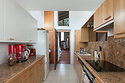 Interior, domestic kitchen of a house, wooden cabinet