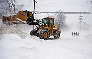 Feb 10,2010 - Herndon, Va USA - Road crews clear streets as a group of locals make their way through the blizzard conditions in historic Herndon, Virginia on Wednesday.(Credit Image: ©Pete Marovich/ZUMA Press)