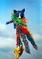 27 April 2014. New Orleans, Louisiana.<br /> Blue Dog on a pole at the New Orleans Jazz and Heritage Festival. Bright and inventive colorful markers are used by friends to find each other in the crowds. <br /> Photo; Charlie Varley/varleypix.com