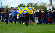 Shrewsbury fans run onto the pitch at full time during the Sky Bet League 2 match between Cheltenham Town and Shrewsbury Town at Whaddon Road, Cheltenham, England on 25 April 2015. Photo by Alan Franklin.