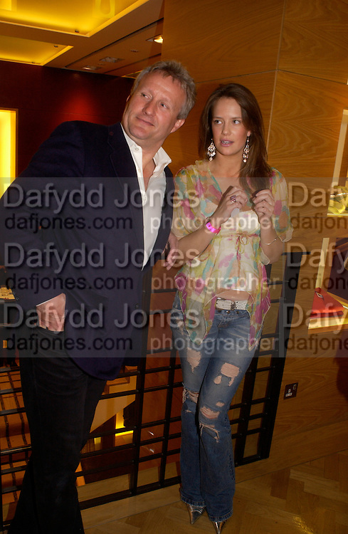 Sebastian Taylor and  Arabella  Musgrave, Burberry party to launch collection in  support of Breakthrough Breast Cancer. New Bond St. shop. Londddon. 5 October 22004. ONE TIME USE ONLY - DO NOT ARCHIVE  © Copyright Photograph by Dafydd Jones 66 Stockwell Park Rd. London SW9 0DA Tel 020 7733 0108 www.dafjones.com