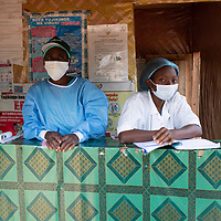 Triage post at Vighole health centre near Butembo. All visitors must pass the triage post, washing or disinfecting their hands and having their name and temperature recorded.  Local health infrastructure was improved and the health teams in the area were supported and strengthened during the Ebola crisis which ended in June 2020. Vighole is near Butembo, North Kivu, DRC.