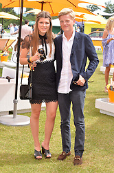 Brother & sister CARINTHIA PEARSON and GEORGE PEARSON at the Veuve Clicquot Gold Cup Final at Cowdray Park Polo Club, Midhurst, West Sussex on 20th July 2014.