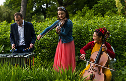 EMBARGOED UNTIL 10AM, WEDNESDAY 2 JUNE<br /> Edinburgh International Festival, Edinburgh, Scotland, United Kingdom: <br /> Pictured: Iain Sandbanks, percussionist, Jenna Reid, on fiddle and Su-a Lee, cellist, in the Royal Botanic Garden.<br /> Edinburgh International Festival pioneers the return of live performance in Scotland from 7–29 August with a diverse programme of UK and international artists. This year's programme features over 170 classical and contemporary music, theatre, opera, dance and spoken word performances, including 15 new commissions and premieres. Audience safety is key with measures including outdoor venues, social distancing, shorter performances without intervals, audience members in bubbles and, for the first time, online access to free performances.   <br /> Sally Anderson | EdinburghElitemedia.co.uk