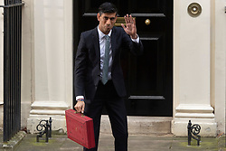 © Licensed to London News Pictures. 11/03/2020. London, UK. Chancellor of the Exchequer Rishi Sunak holds the budget box leaving No.11 Downing St to present his first budget in Parliament. Photo credit: Ray Tang/LNP