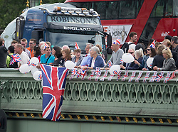 © Licensed to London News Pictures. 15/06/2016. London, UK. Vote Leave campaigners stand on Westminster Bridge as remain and leave boats converge in a flotilla on the Thames near Parliament. Photo credit: Peter Macdiarmid/LNP