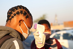 South Africa - Durban - 08 June 2020 - Neliswa Mbeje from Sbongindlela High School has her temperature tested at the school gate<br /> Picture: Doctor Ngcobo/African News Agency(ANA)