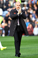 Burnley Manager Sean Dyce makes his way across the pitch prior to kick off. Barclays Premier league match, Burnley v Everton at Turf Moor in Burnley, Lancs on Sunday 26th October 2014.<br /> pic by Chris Stading, Andrew Orchard sports photography.