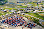 Nederland, Zuid-Holland, Rotterdam, 10-06-2015; metro onderweg tussen Pernis en Hoogvliet passeert<br />  Knooppunt Benelux (A4 / A15). Overslag van containers op terrein ECT Prins Willem-Alexanderhaven, Vondelingeweg.<br /> Infrastructure of motorways and metro (subway), container terminal in Rotterdam harbour area.<br /> <br /> luchtfoto (toeslag op standard tarieven);<br /> aerial photo (additional fee required);<br /> copyright foto/photo Siebe Swart