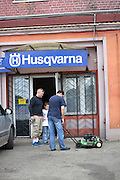 Customers picking up repaired lawnmower at the Husqvarna shop. Tomaszow Mazowiecki Central Poland