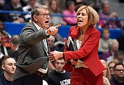Connecticut coach Geno Auriemma, left, is held back by associate head coach Chris Dailey, right, as he argues a call during the first half of the team's NCAA college basketball game against Baylor, Thursday, Jan. 9, 2020, in Hartford, Conn. (AP Photo/Jessica Hill)