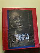 Portrait of dennis matted on cardboard framed with red tape b/w photo with arc of the covenant 11x12 in<br />