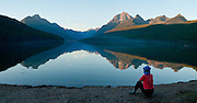 Rocky Mountains reflect in Bowman Lake, Glacier National Park, Montana, USA. (Panorama stitched from 3 overlapping images.)