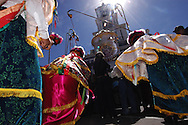 Bolivia. Tarija. San Roque..Before starting the procession is the Chunchos kneel to the saint, they will do several times during the procession.