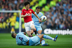MANCHESTER, ENGLAND - Monday, April 30, 2012: Manchester United's Park Ji-Sung in action against Manchester City during the Premiership match at the City of Manchester Stadium. (Pic by David Rawcliffe/Propaganda)