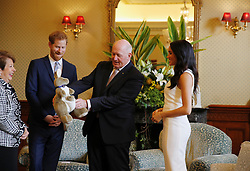 Australia's Governor General Peter Cosgrove gives the Duke and Duchess of Sussex a toy kangaroo - with a baby - at Admiralty House in Sydney on the first day of the royal couple's visit to Australia.