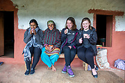 ICS Volunteers having a cup of tea with their host home Mum at their homestay. Devichou, Karyabinayak, Nepal. ICS / Restless Development volunteers in the Dakshinkali region of Nepal. (© Andy Aitchison / ICS)