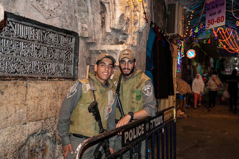 Jerusalem - July 24, 2013: Israeli border police stationed inside the Muslim Quarter of Jerusalem's Old City.