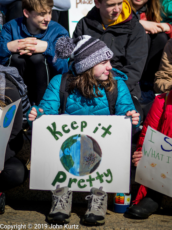 """15 MARCH 2019 - ST. PAUL, MINNESOTA, USA: A high school student holds a sign during the MN Youth for Climate Justice """"Climate Strike"""" at the Minnesota State Capitol in St. Paul, MN. Thousands of high school students braved below freezing temperatures and biting winds to demand action on climate change. The Minnesota Climate Strike was inspired by the strike by Greta Thunberg, a Swedish high school student, who started a climate strike at her school in August 2018.        PHOTO BY JACK KURTZ"""