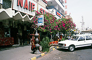 Naif Store shops and hotel city centre street in Aqaba, Jordan, 1998