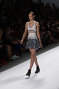 A sporty patterned skirt with coordinated top with cut out front by Richard Chai at the Spring 2013 Mercedes Benz Fashion Week show in New York.