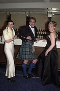 Lucy Bathurst, David McNair-Scott and Samantha Meredith. the Royal Caledonian Ball. 2001. Grosvenor house. London. 3 May 2001. © Copyright Photograph by Dafydd Jones 66 Stockwell Park Rd. London SW9 0DA Tel 020 7733 0108 www.dafjones.com