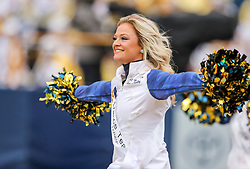 Nov 23, 2019; Morgantown, WV, USA; A West Virginia Mountaineers dancer performs during the third quarter against the Oklahoma State Cowboys at Mountaineer Field at Milan Puskar Stadium. Mandatory Credit: Ben Queen-USA TODAY Sports