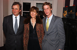 Left to right, VISCOUNT & VISCOUNTESS ASTOR and their son the HON.JAKE ASTOR at a party hosted by jeweller Theo Fennell and Dominique Heriard Dubreuil of Remy Martin fine Champagne Cognac entitles 'Hot Ice' held at 35 Belgrave Square, London, W1 on 26th October 2004.<br /><br />NON EXCLUSIVE - WORLD RIGHTS