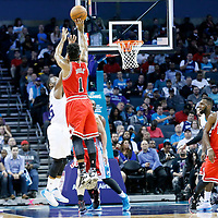 03 November 2015: Chicago Bulls guard Derrick Rose (1) takes a jump shot over Charlotte Hornets guard Kemba Walker (15) during the Charlotte Hornets  130-105 victory over the Chicago Bulls, at the Time Warner Cable Arena, in Charlotte, North Carolina, USA.
