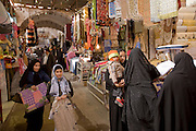 Shoppers go about their business inside a souk (market) in the central Iranian desert city of Yazd, one of the oldest continuously inhabited places on earth. (From the book What I Eat: Around the World in 80 Diets.)