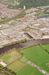 Aerial view of football pitches along the Trent river in Nottingham, The redroofed building in the centre belongs to NTL, The Colwick woods are at the top of the picture,