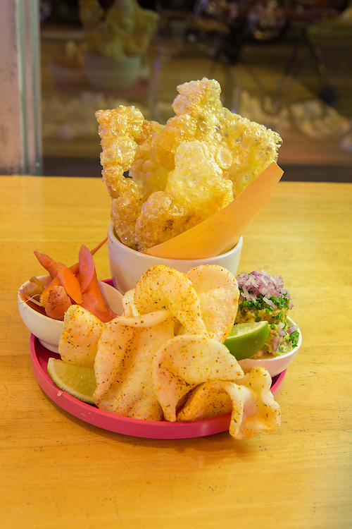 New York, NY - 11 February 2014. An appetizer of guacamole, shrimp chips and chicharronnes at Mission Cantina, Danny Bowien's latest restaurant in New York's Lower East Side.