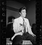 Y-570902B-11.  Elvis at the Multnomah Athletic club, adjacent to the stadium, where he met with newsmen and photographers in a half-hour press conference. September 2, 1957