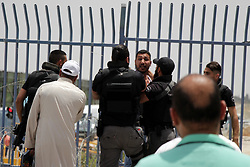 May 24, 2019, Qalandia, West Bank, Palestinian Territory: Israeli border police detain a Palestinian youth trying to cross to Jerusalem's al-Aqsa mosque, at the Qalandia Israeli checkpoint, betweeen Jerusalem and the West Bank city of Ramallah, May 25, 2019. The Israeli authorities reportedly banned Palestinian men under the age of 40 from entering East Jerusalem, although women were allowed in  (Credit Image: © Ayat Arqawy/APA Images via ZUMA Wire)