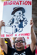 25 JUNE 2012 - PHOENIX, AZ:  Protesters on the street in front of the Immigration and Customs Enforcement (ICE) offices in central Phoenix Monday. About 100 immigration supporters held a protest against ICE and continued deportations by the Obama administration. Protesters also celebrated the US Supreme Court decision to overturn most of SB1070, Arizona's tough anti-immigration law.      PHOTO BY JACK KURTZ
