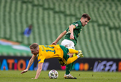 DUBLIN, REPUBLIC OF IRELAND - Sunday, October 11, 2020: Republic of Ireland's Jayson Molumby tackles Wales' Joseff Morrell during the UEFA Nations League Group Stage League B Group 4 match between Republic of Ireland and Wales at the Aviva Stadium. The game ended in a 0-0 draw. (Pic by David Rawcliffe/Propaganda)
